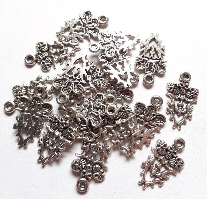 Lot de 18 breloques tête de mort argenté - Charms pour la confection de bijoux